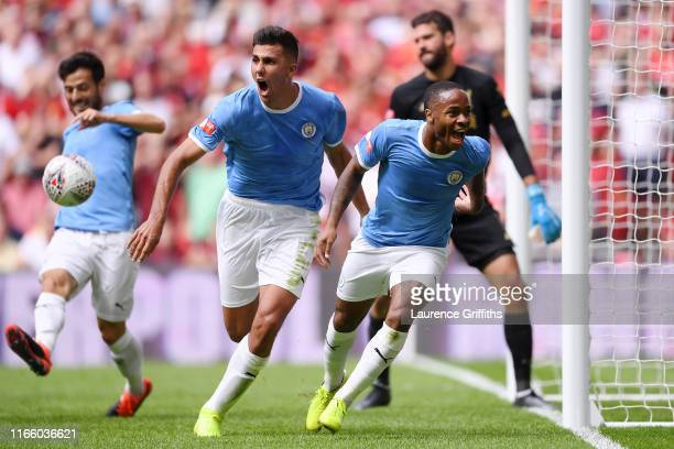 Raheem Sterling of Manchester City celebrates after scoring his team's first goal during the FA Community Shield match between Liverpool and...
