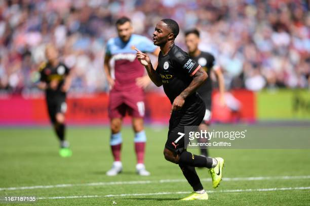 Raheem Sterling of Manchester City celebrates after scoring his team's third goal during the Premier League match between West Ham United and...