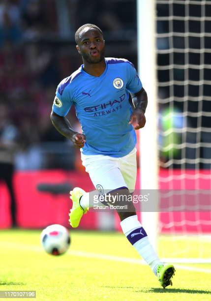 Raheem Sterling of Manchester City celebrates after scoring his team's second goal during the Premier League match between AFC Bournemouth and...