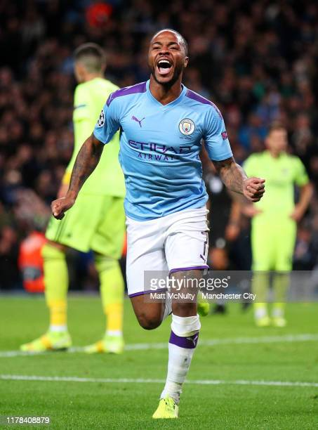 Raheem Sterling of Manchester City celebrates after scoring his team's first goal during the UEFA Champions League group C match between Manchester...