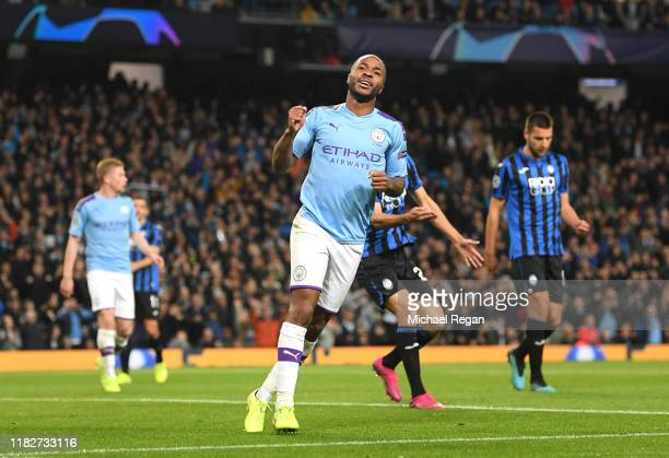 Raheem Sterling of Manchester City celebrates after scoring his team's third goal during the UEFA Champions League group C match between Manchester...
