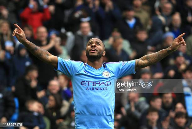 Raheem Sterling of Manchester City celebrates after scoring his team's first goal during the Premier League match between Manchester City and Aston...