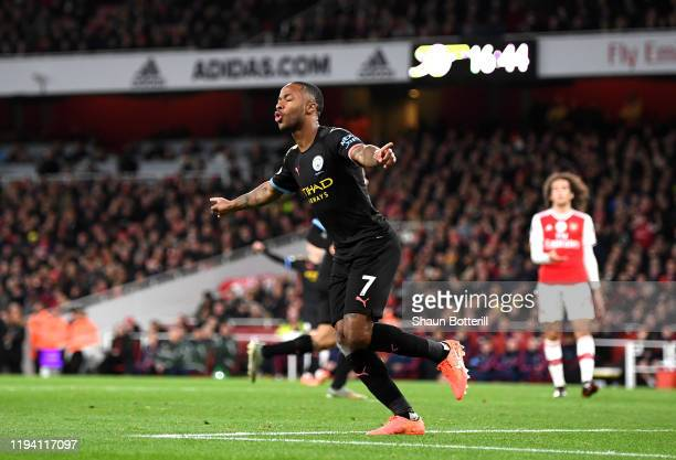 Raheem Sterling of Manchester City celebrates after scoring his team's second goal during the Premier League match between Arsenal FC and Manchester...