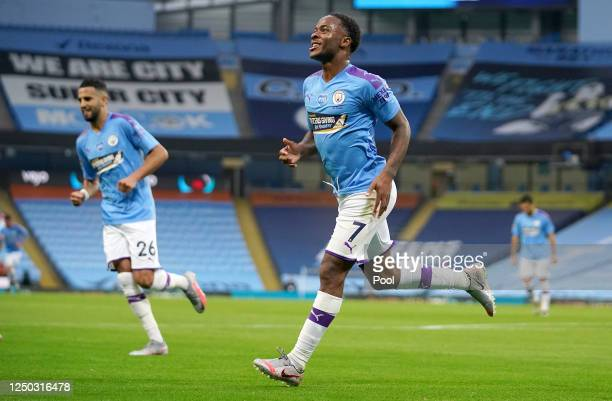 Raheem Sterling of Manchester City celebrates after scoring his team's first goal during the Premier League match between Manchester City and Arsenal...
