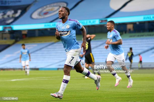 Raheem Sterling of Manchester City celebrates after scoring his teams first goal during the Premier League match between Manchester City and Arsenal...