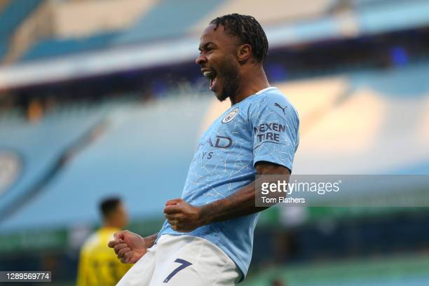 Raheem Sterling of Manchester City celebrates after scoring his team's first goal during the Premier League match between Manchester City and Fulham...