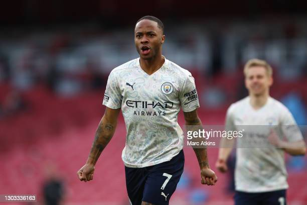 Raheem Sterling of Manchester City celebrates after scoring his team's first goal during the Premier League match between Arsenal and Manchester City...