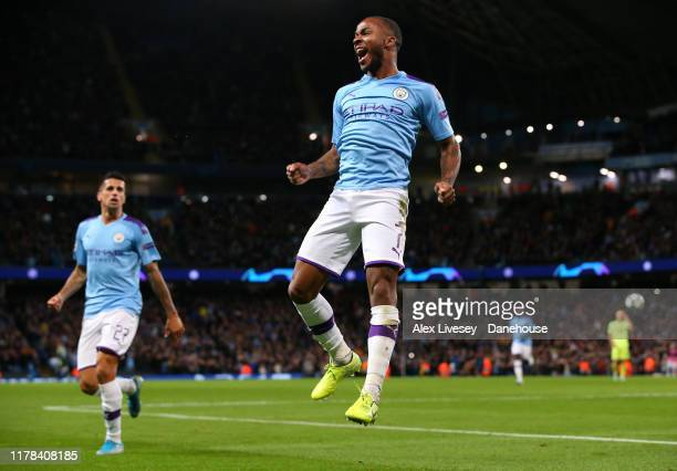 Raheem Sterling of Manchester City celebrates after scoring the opening goal during the UEFA Champions League group C match between Manchester City...