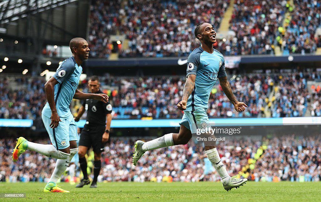 Raheem Sterling of Manchester City celebrates scoring his second goal and his team's third with Fernandinho of Manchester City during the Premier League match between Manchester City and West Ham United at Etihad Stadium on August 28, 2016 in Manchester, England.