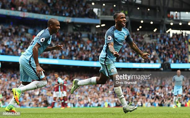 Raheem Sterling of Manchester City celebrates scoring his second goal and his team's third with Fernandinho of Manchester City during the Premier...