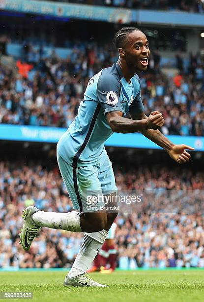 Raheem Sterling of Manchester City celebrates scoring his second goal and his team's third during the Premier League match between Manchester City...
