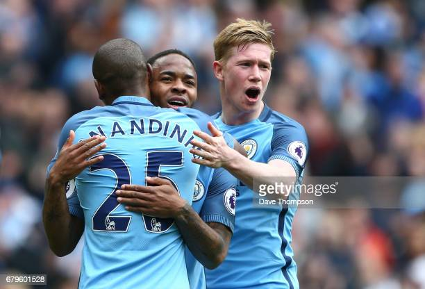 Raheem Sterling of Manchester City celebrates scoring his sides fourth goal with Fernandinho of Manchester City and Kevin De Bruyne of Manchester...