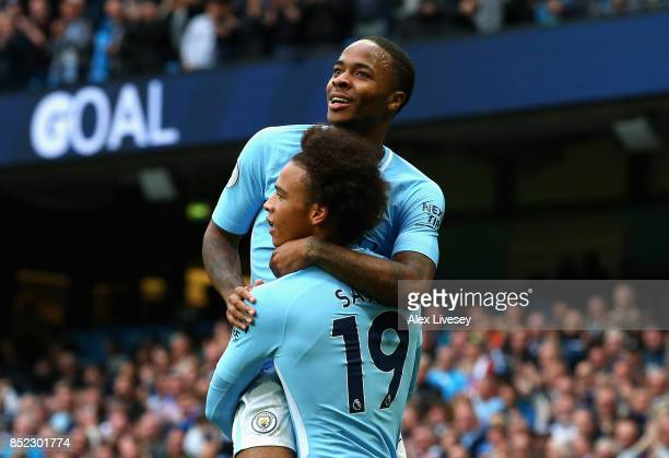 Raheem Sterling of Manchester City celebrates scoring his sides second goal with Leroy Sane of Manchester City during the Premier League match...