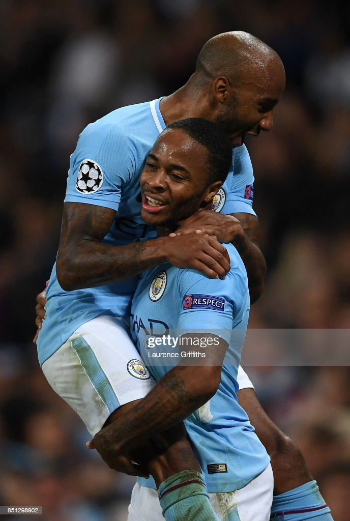 Raheem Sterling of Manchester City celebrates scoring his sides second goal with Fabian Delph of Manchester City during the UEFA Champions League Group F match between Manchester City and Shakhtar Donetsk at Etihad Stadium on September 26, 2017 in Manchester, United Kingdom.