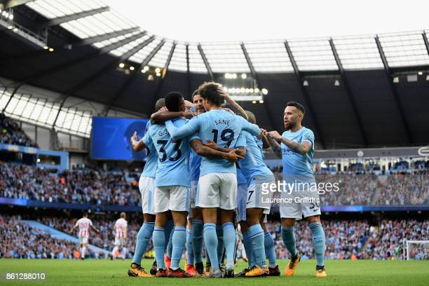 Raheem Sterling of Manchester City celebrates scoring his sides second goal with Gabriel Jesus of Manchester City and his team mates during the...