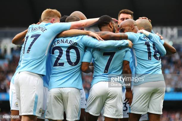 Raheem Sterling of Manchester City celebrates scoring his side's second goal with team mates during the Premier League match between Manchester City...