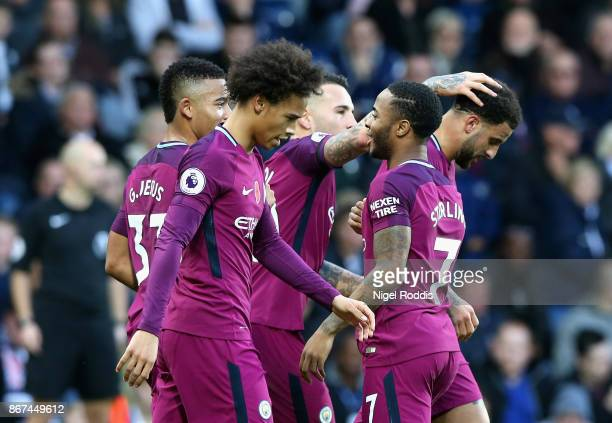 Raheem Sterling of Manchester City celebrates scoring his sides third goal with his Manchester City team mates during the Premier League match...