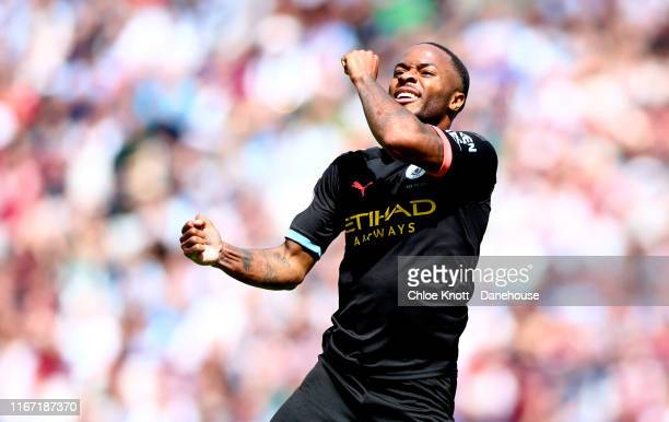 Raheem Sterling of Manchester City celebrates scoring his teams third goal during the Premier League match between West Ham United and Manchester...