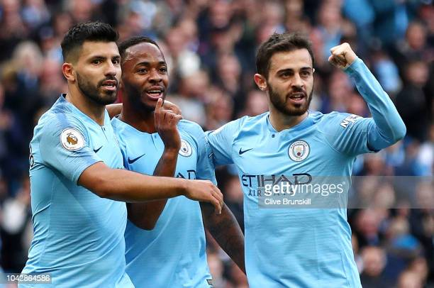 Raheem Sterling of Manchester City celebrates scoring the opening goal with Sergio Aguero and Bernardo Silva during the Premier League match between...
