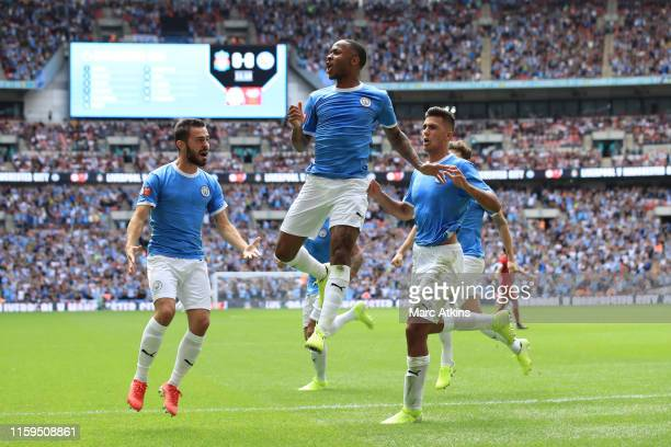 Raheem Sterling of Manchester City celebrates scoring the opening goal during the FA Community Shield match between Liverpool and Manchester City at...