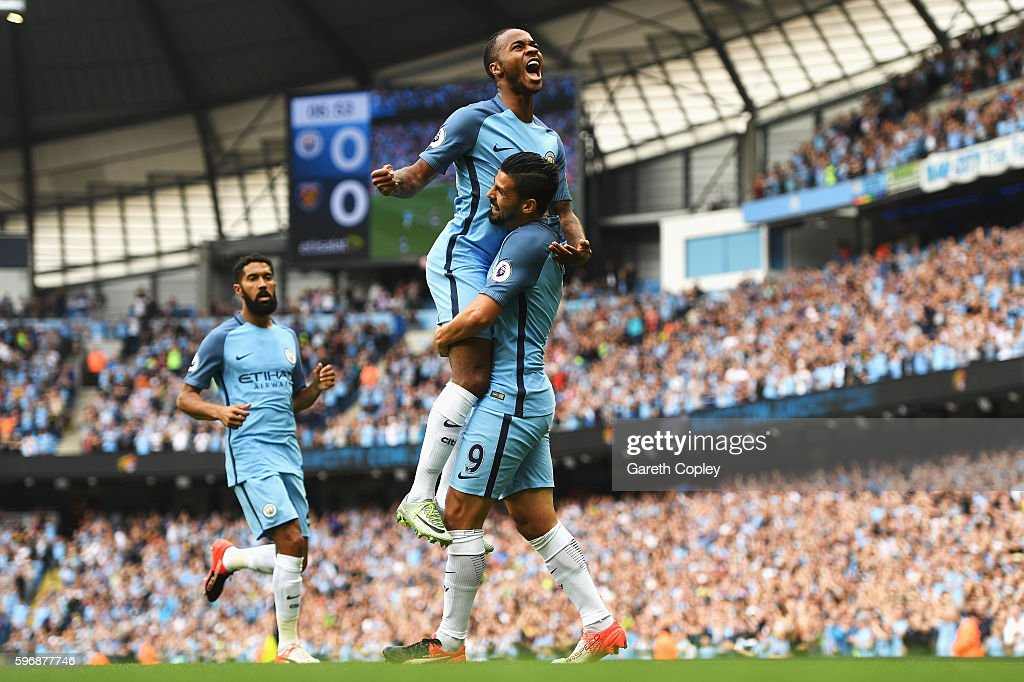 Raheem Sterling of Manchester City celebrates scoring the opening goal with Nolito during the Premier League match between Manchester City and West Ham United at Etihad Stadium on August 28, 2016 in Manchester, England.