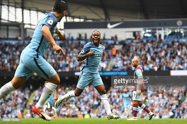Raheem Sterling of Manchester City celebrates scoring the opening goal during the Premier League match between Manchester City and West Ham United at...