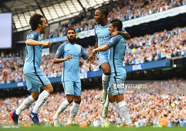 Raheem Sterling of Manchester City celebrates scoring the opening goal with Nolito Gael Clichy and David Silva during the Premier League match...