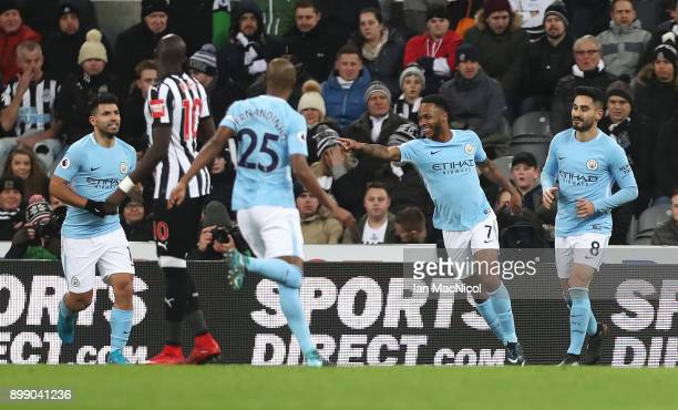 Raheem Sterling of Manchester City celebrates scoring the opening goal with team mates during the Premier League match between Newcastle United and...