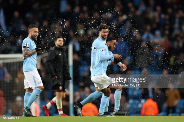 Raheem Sterling of Manchester City celebrates victory with Nicolas Otamendi of Manchester City during the Premier League match between Manchester...