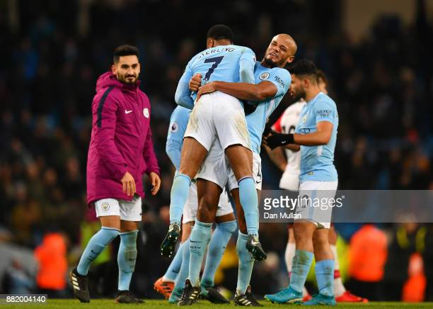 Raheem Sterling of Manchester City celebrates victory with Vincent Kompany of Manchester City after the Premier League match between Manchester City...