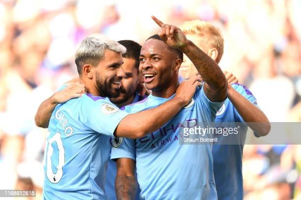 Raheem Sterling of Manchester City celebrates with his team after scoring his sides first goal during the Premier League match between Manchester...