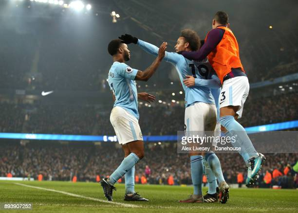 Raheem Sterling of Manchester City celebrates with Leroy Sane after scoring the third goal during the Premier League match between Manchester City...