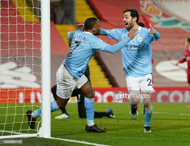 Raheem Sterling of Manchester City celebrates with team mate Bernardo Silva after scoring their side's third goal during the Premier League match...