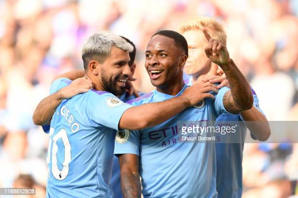 Raheem Sterling of Manchester City celebrates with team mates after scoring his team's first goal during the Premier League match between Manchester...