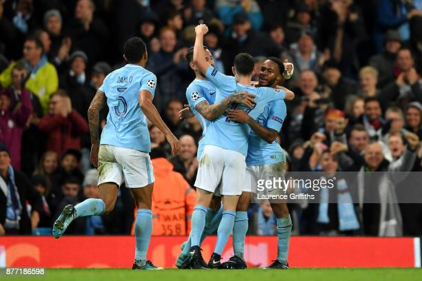 Raheem Sterling of Manchester City celebrates with team mates after scoring his sides first goal during the UEFA Champions League group F match...