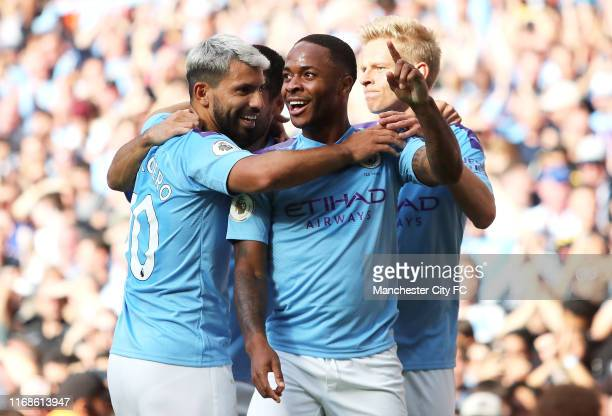 Raheem Sterling of Manchester City celebrates with team mates Sergio Aguero and Oleksandr Zinchenko after scoring his team's first goal during the...