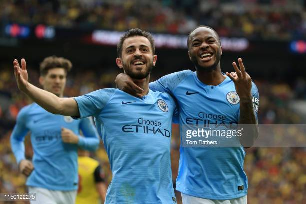 Raheem Sterling of Manchester City celebrates with teammate Bernardo Silva after scoring his team's fifth goal during the FA Cup Final match between...