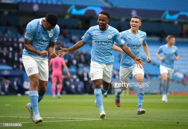 Raheem Sterling of Manchester City celebrates with teammate Gabriel Jesus after scoring his team's first goal during the UEFA Champions League round...