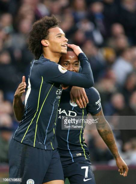Raheem Sterling of Manchester City celebrates with teammate Leroy Sane after scoring his team's second goal during the Premier League match between...