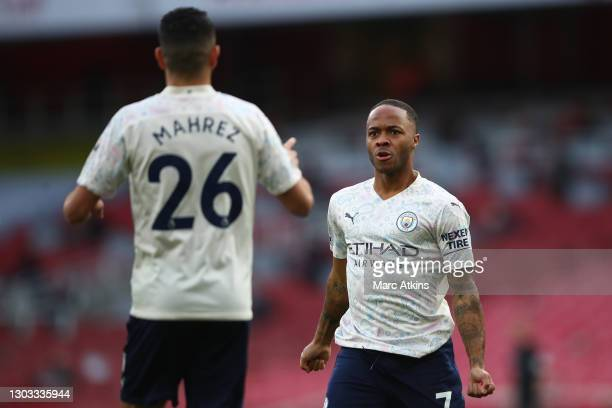 Raheem Sterling of Manchester City celebrates with teammate Riyad Mahrez after scoring his team's first goal during the Premier League match between...
