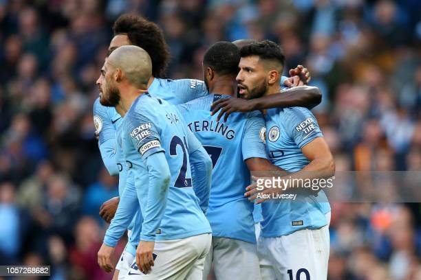 Raheem Sterling of Manchester City celebrates with teammates after scoring his team's fourth goal during the Premier League match between Manchester...