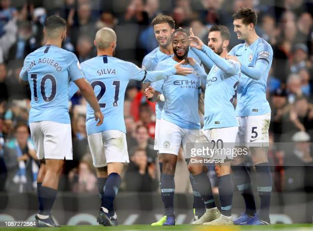 Raheem Sterling of Manchester City celebrates with teammates after scoring his team's fifth goal during the Premier League match between Manchester...