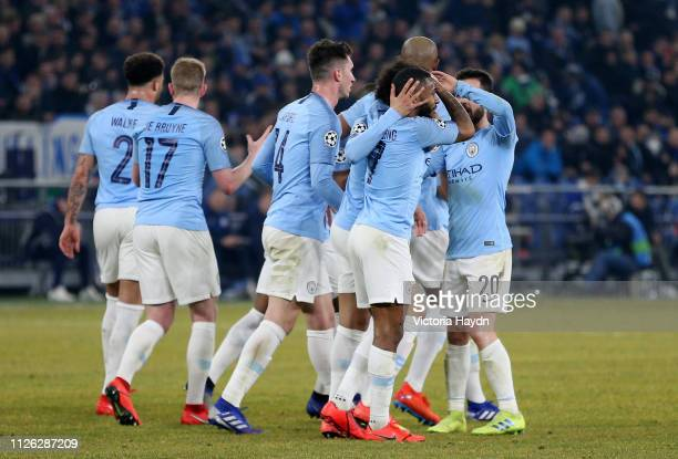 Raheem Sterling of Manchester City celebrates with teammates after scoring his team's third goal during the UEFA Champions League Round of 16 First...