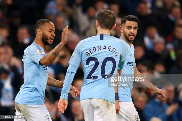 Raheem Sterling of Manchester City celebrates with teammates after scoring his team's second goal during the Premier League match between Manchester...