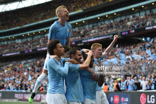 Raheem Sterling of Manchester City celebrates with teammates after scoring his team's fifth goal during the FA Cup Final match between Manchester...