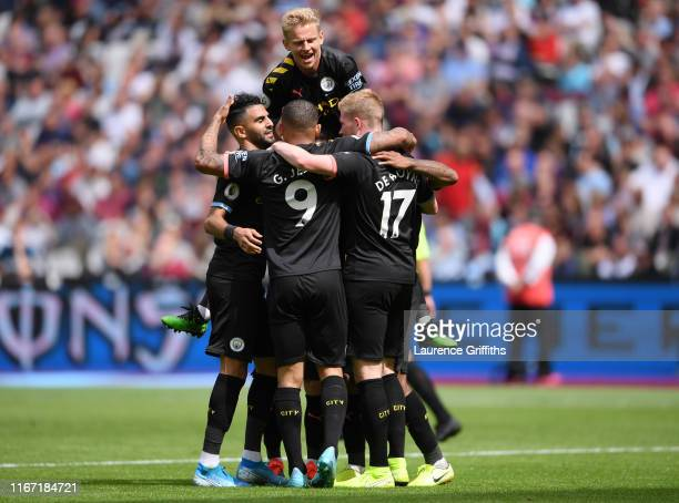Raheem Sterling of Manchester City celebrates with teammates after scoring his team's second goal with his team mates during the Premier League match...