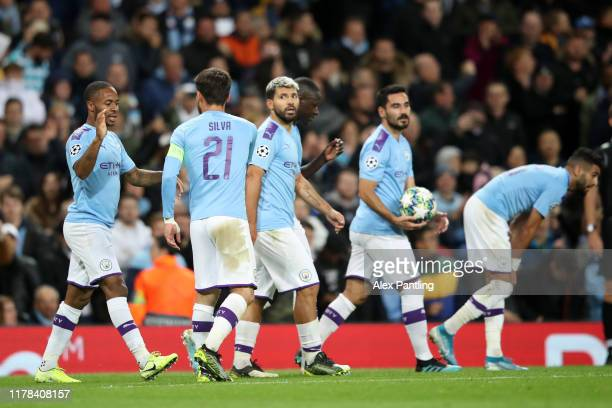 Raheem Sterling of Manchester City celebrates with teammates after scoring his team's first goal during the UEFA Champions League group C match...