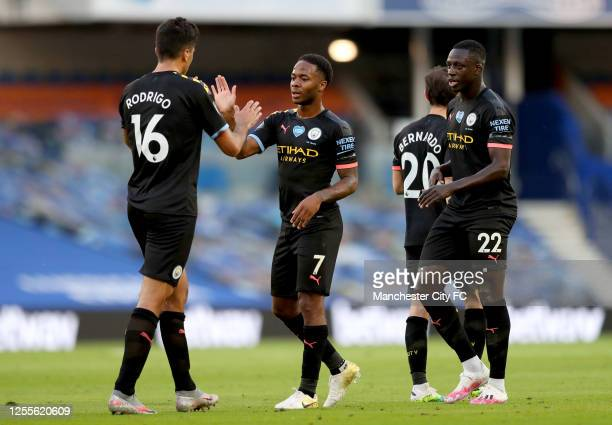 Raheem Sterling of Manchester City celebrates with teammates after scoring his team's first goal during the Premier League match between Brighton &...