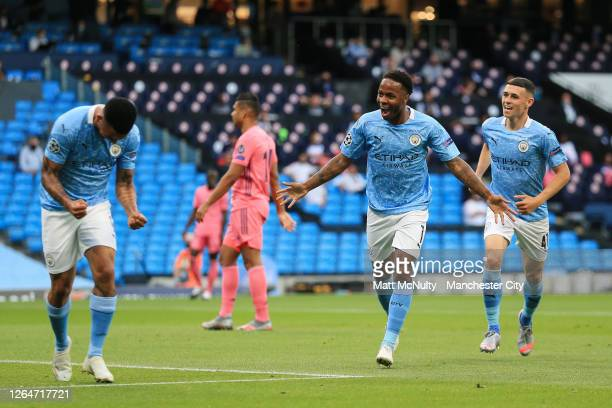 Raheem Sterling of Manchester City celebrates with teammates after scoring his teams first goal during the UEFA Champions League round of 16 second...