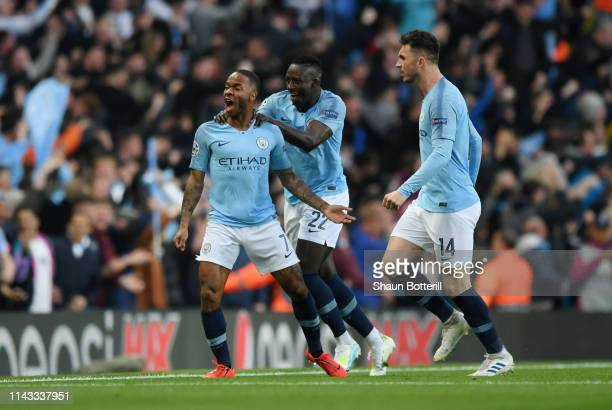 Raheem Sterling of Manchester City celebrates with teammates Benjamin Mendy and Aymeric Laporte after scoring his team's first goal during the UEFA...